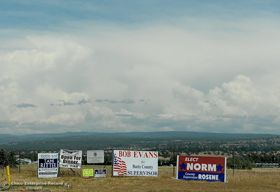 Campaign signs and clouds are seen along Cohassett Road in Chico, Calif. Tuesday May 15, 2018. (Bill Husa -- Enterprise-Record)