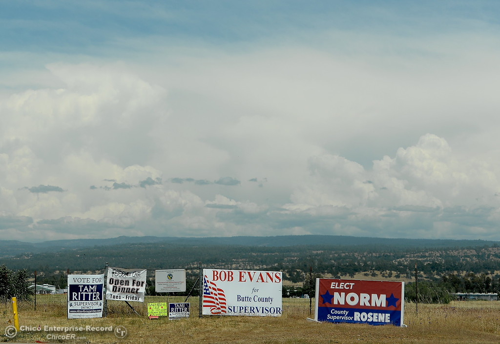 . Campaign signs and clouds are seen along Cohassett Road in Chico, Calif. Tuesday May 15, 2018. (Bill Husa -- Enterprise-Record)