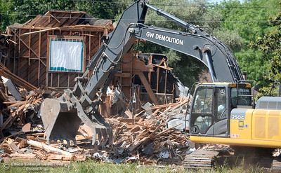 A large excavatior makes quick work of the old buildings as demolition is underway of the old Salvation Army building and church located on the corner of East 16th Street and Laurel St. in Chico, Calif. Mon. May 14, 2018.  (Bill Husa -- Enterprise-Record)
