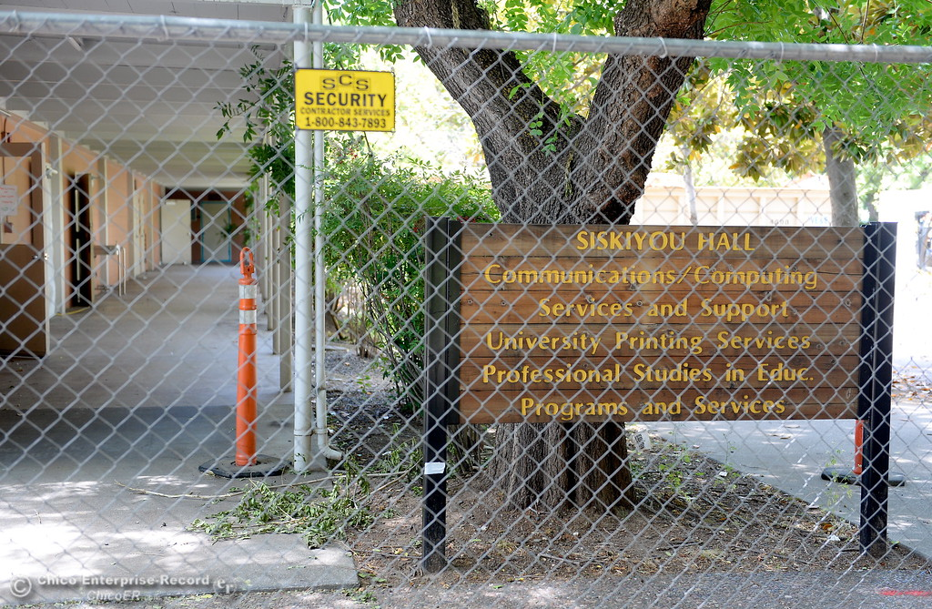 . Siskiyou Hall is fenced off as demolition is underway at Chico State Universitiy in Chico, Calif. Wednesday May 30, 2018. (Bill Husa -- Enterprise-Record)