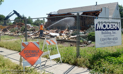 The sidewalk along E. 16th Street is closed while demolition is underway of the old Salvation Army building and church located on the corner of East 16th Street and Laurel St. in Chico, Calif. Mon. May 14, 2018.  (Bill Husa -- Enterprise-Record)