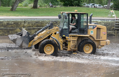 City of Chico Senior Maintenance worker Kyle Phillips operates the loader while cleaning out Sycamore Pool at One Mile Recreation Area in Bidwell Park Wed. May 16, 2018.  (Bill Husa -- Enterprise-Record)
