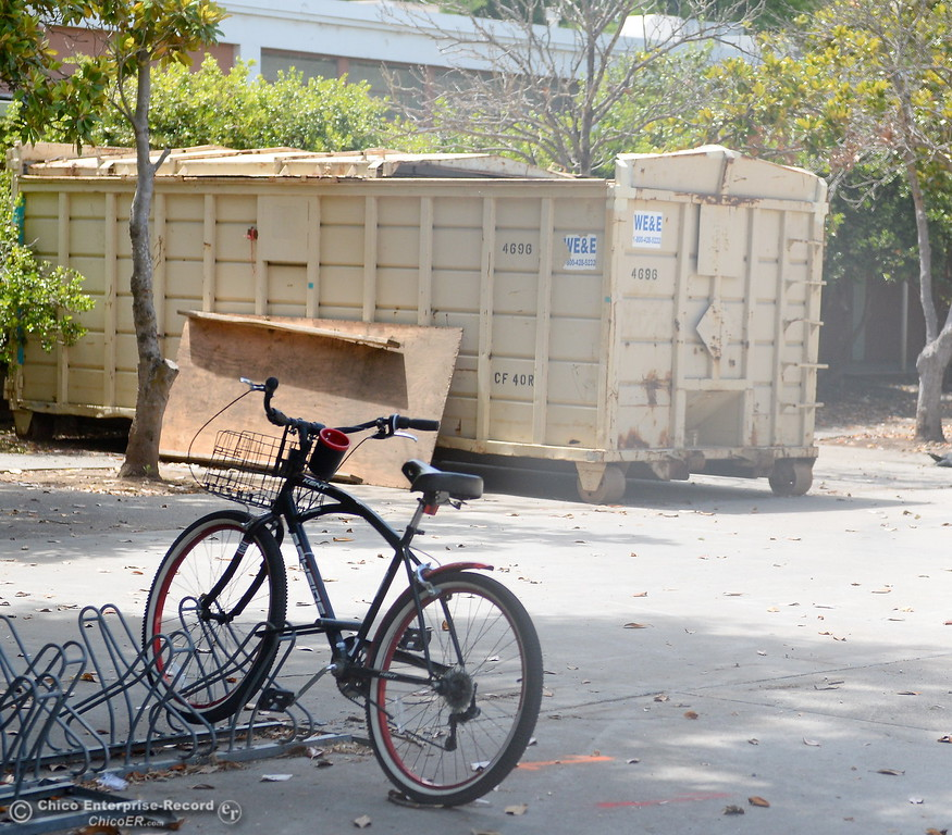 . A bicycle remains in the rack while Siskiyou Hall is fenced off and demolition is underway at Chico State Universitiy in Chico, Calif. Wednesday May 30, 2018. (Bill Husa -- Enterprise-Record)