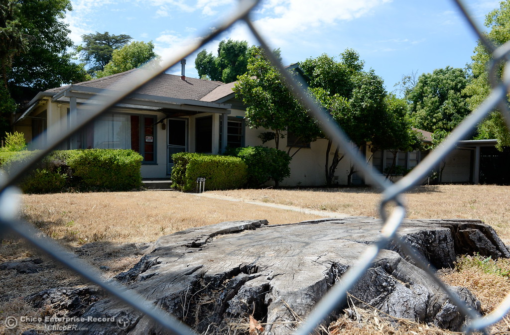 . This home along Warner Street once had a large tree growing in the front yard but is now fenced off and scheduled for demolition as construction around Chico State University is underway in Chico, Calif. Wednesday May 30, 2018. (Bill Husa -- Enterprise-Record)