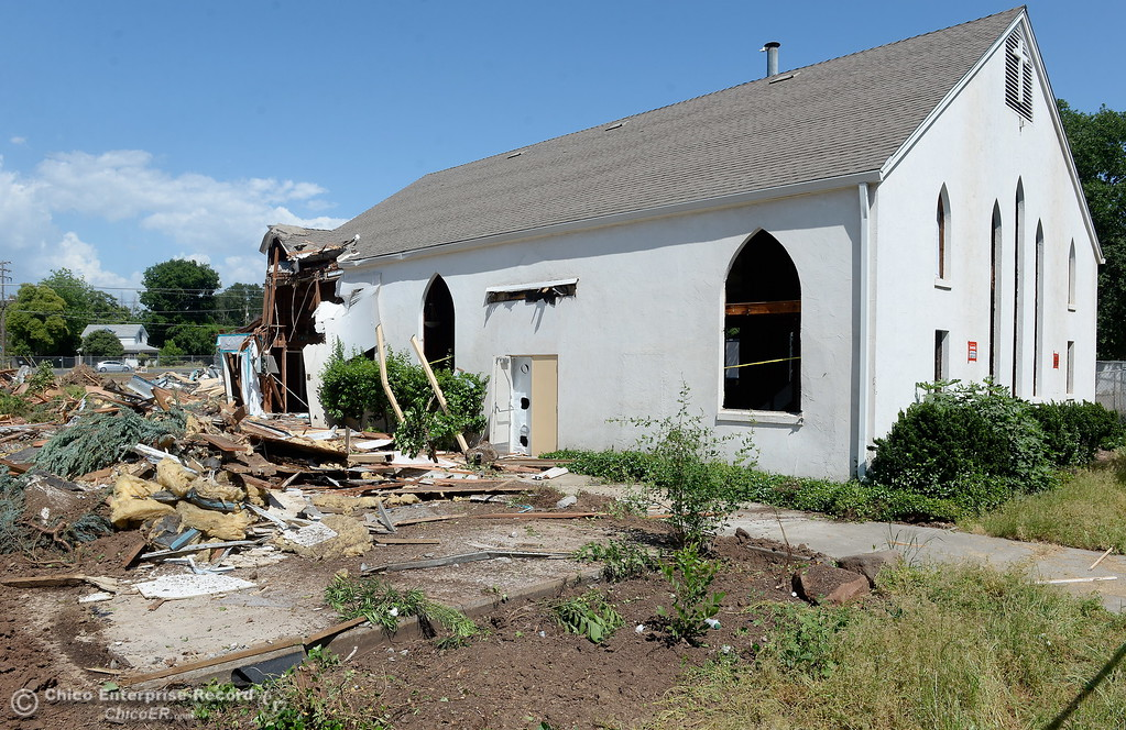 . The Church is the only things still standing Monday afternoon as demolition is underway of the old Salvation Army building and church located on the corner of East 16th Street and Laurel St. in Chico, Calif. Mon. May 14, 2018.  (Bill Husa -- Enterprise-Record)