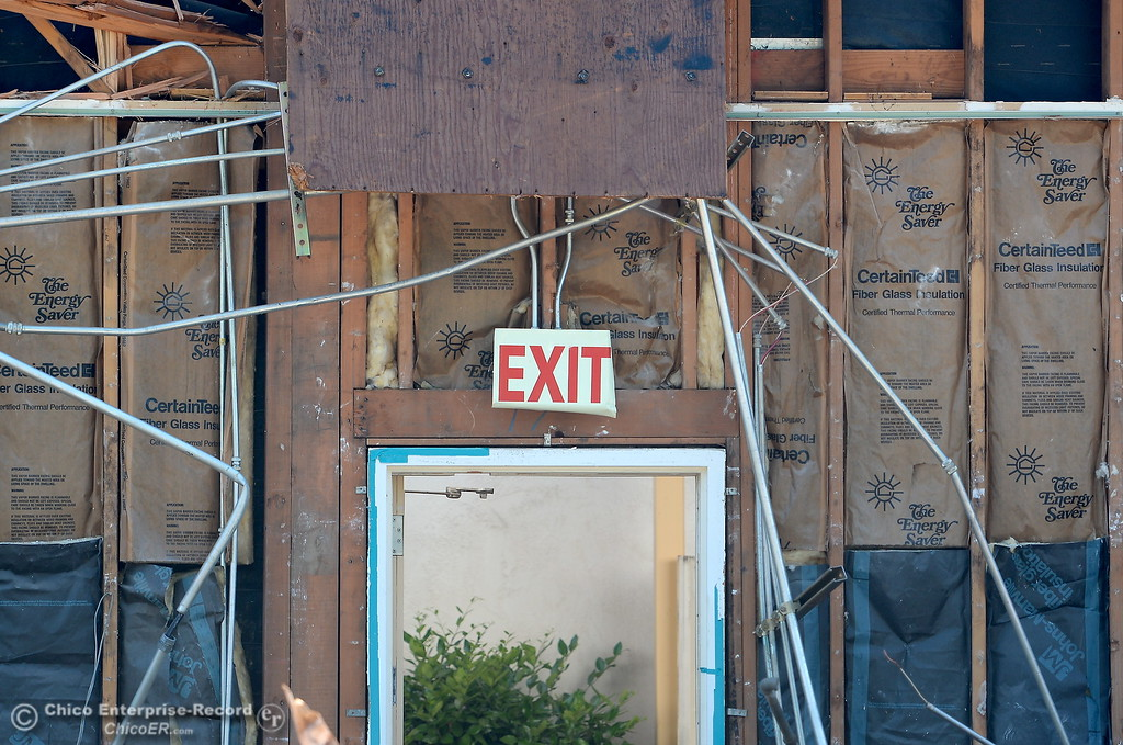 . An interior exit sign is seen from the outside as demolition is underway of the old Salvation Army building and church located on the corner of East 16th Street and Laurel St. in Chico, Calif. Mon. May 14, 2018.  (Bill Husa -- Enterprise-Record)