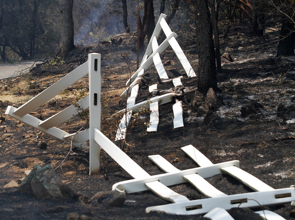 . A fence that fell victim to the Wall Fire flames Saturday July 8, 2017 in Oroville, California.  (Emily Bertolino -- Enterprise-Record)
