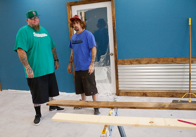 Stairways Programming executive director Michael Madiero, right, and Jeremy Williams work to finish the new harm reduction and legal center Friday July 7, 2017 in Chico, California.  (Emily Bertolino -- Enterprise-Record)