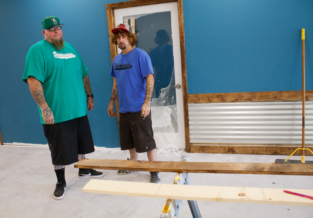 . Stairways Programming executive director Michael Madiero, right, and Jeremy Williams work to finish the new harm reduction and legal center Friday July 7, 2017 in Chico, California.  (Emily Bertolino -- Enterprise-Record)
