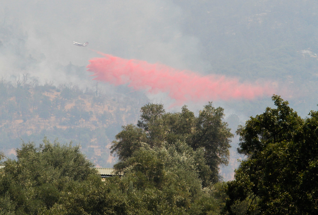 . An air tanker drops fire retardant along the Wall Fire line as crews work to contain the wildfire that has grown to 2,000 acres at the time this picture was taken Saturday July 8, 2017 in Oroville, California.  (Emily Bertolino -- Enterprise-Record)