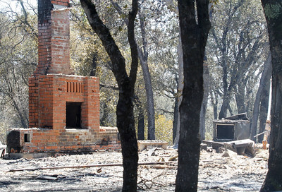 A chimney stands where the Wall Fire swept through along Forbestown Road Sunday July 9, 2017 in Oroville , California.  (Emily Bertolino -- Enterprise-Record)