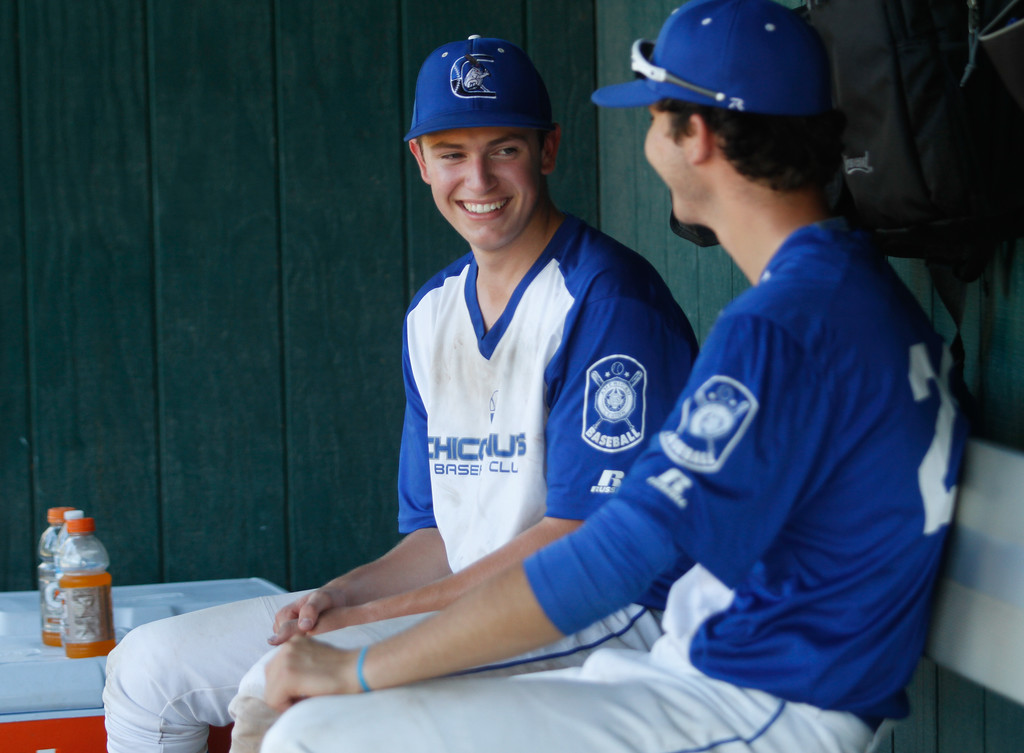 . Chico Nuts Ryan Farrell talks with a teammate as they host the Humboldt Eagles in a doubleheader Saturday July 8, 2017 at Hooker Oak Park in Chico, California.  (Emily Bertolino -- Enterprise-Record)