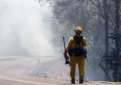 A firefighter heads into a cloud of smoke as the Wall Fire reaches 5,000 acres Sunday July 9, 2017 in Oroville , California.  (Emily Bertolino -- Enterprise-Record)