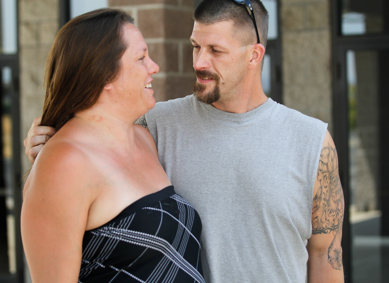 At the Wall Fire evacuation center Sharon Raitan and Josh Cornelision embrace as they two fear they may have lost their home in the Wall Fire Saturday July 8, 2017 at the  Church of the Nazarene in Oroville, California.  (Emily Bertolino -- Enterprise-Record)
