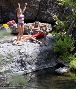 Samantha Rodriguez and Skylar Diggins of Chico get excited as some of their friends arrive to join them for a swim in the cool waters of Big Chico Creek at Bear Hole in Upper Bidwell Park Thursday, July 12, 2018.  (Bill Husa -- Enterprise-Record)