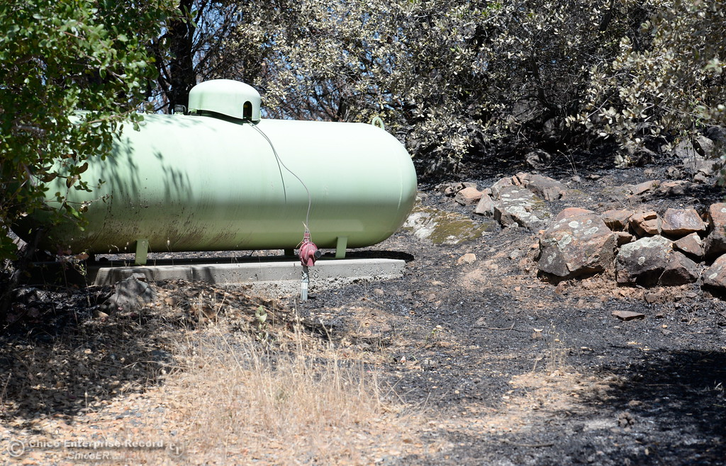 . A propane tank that had fire creeping right up to it is seen after the Wall Fire near Oroville, Calif. Mon. July 10, 2017. (Bill Husa -- Enterprise-Record)