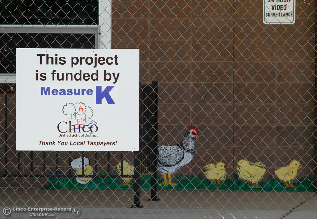 ". A sign stating, ""This project is funded by Measure K,\"" on a gate around Shasta School as the reconstruction project begins Friday July 14, 2017 in Chico, California.  (Emily Bertolino -- Enterprise-Record)"