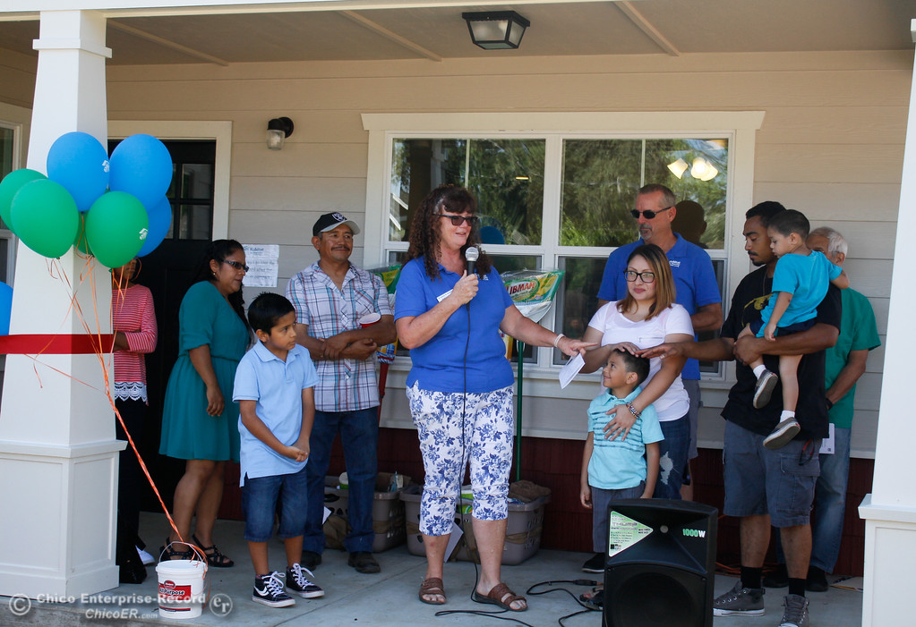 . Mary Shippen, center, current Habitat homeowner introduces the newest members of the community the Hernandez, left, and Bruhns families at the Humanity of Butte County Home Dedication Ceremony Saturday July 15, 2017 in Chico, California.  (Emily Bertolino -- Enterprise-Record)