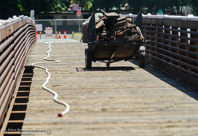 The wooden Ceres Avenue bike bridge over Lindo Channel is being resurfaced with concrete Tuesday July 11, 2017 in Chico , California.  (Emily Bertolino -- Enterprise-Record)