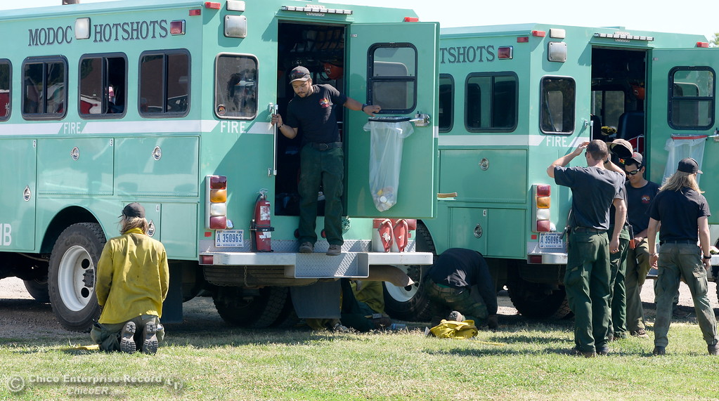 . Modoc Hot Shots are seen near a truck at the Silver Dollar Fair Incident Command area for the Wall Fire near Oroville, Calif. Mon. July 10, 2017. (Bill Husa -- Enterprise-Record)