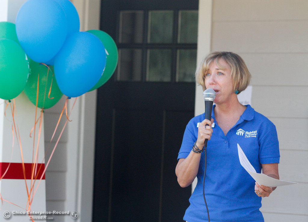 . Habitat for Humanity executive director Nicole Bateman welcomes everyone to the Habitat for Humanity of Butte County Home Dedication Ceremony Saturday July 15, 2017 in Chico, California.  (Emily Bertolino -- Enterprise-Record)