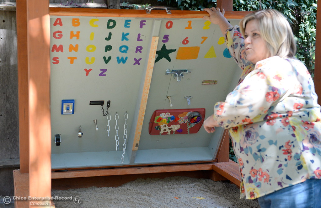 . Shelly Watson, Jesus Center Director of Services shows a sandbox complete with a lid full of visuals as she gives a tour of the Lily House in Chico, Calif. Thurs. July 13, 2017. Lily House is the Jesus Center\'s new home for pregnant mothers/mothers with newborns. (Bill Husa -- Enterprise-Record)