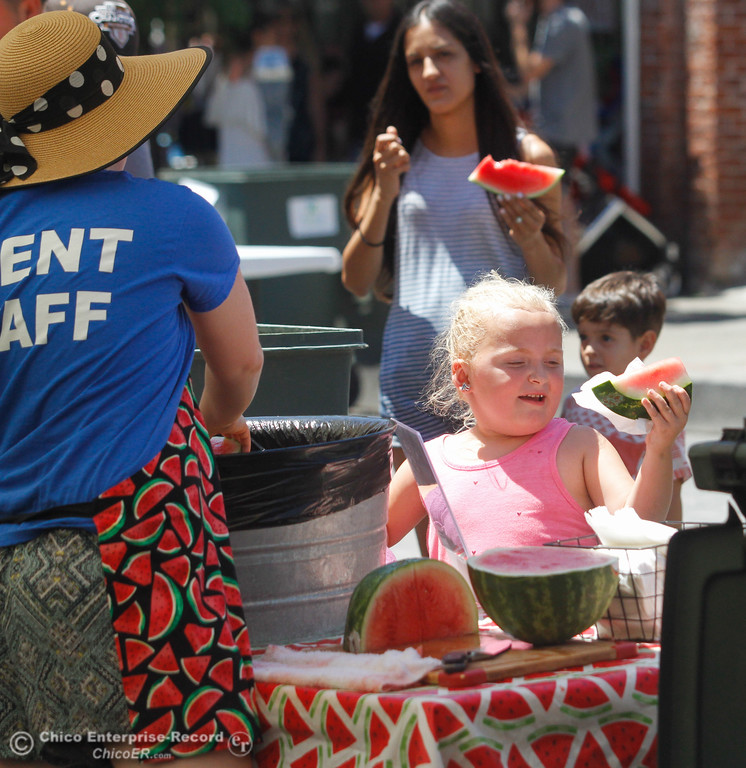 . Savanna Adams Beard, 5, picks up a slice of watermelon during the annual Slice of Chico Saturday July 15, 2017 in Chico, California.  (Emily Bertolino -- Enterprise-Record)