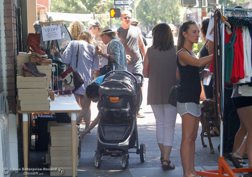 . People browse merchandise in front of Ruby\'s during the annual Slice of Chico Saturday July 15, 2017 in Chico, California.  (Emily Bertolino -- Enterprise-Record)
