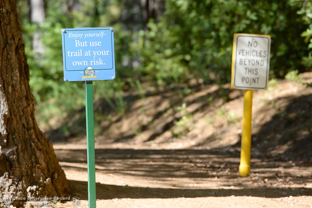 . Signs are seen posted on the walking trails at Paradise Lake Tuesday July 18, 2017. (Bill Husa -- Enterprise-Record)