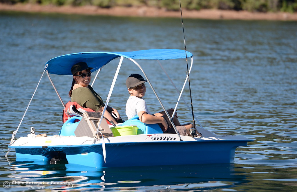 . Quality Time-  Debbie Muniz and her son Joseph enjoy some quality time and a little fishing in their paddleboat at Paradise Lake Tuesday July 18, 2017. (Bill Husa -- Enterprise-Record)