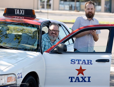 Taxi drivers Shawn Heater, Erik Schmidt left to right smile beside a cab company car in Chico, Calif. Monday 7-17-2017. (Bill Husa -- Enterprise-Record)
