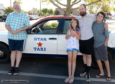 Taxi drivers Shawn Heater left and Erik Schmidt pose beside a Star Taxi with Erik's children Luna 11 and Judith 13, in Chico, Calif. Monday 7-17-2017. (Bill Husa -- Enterprise-Record)
