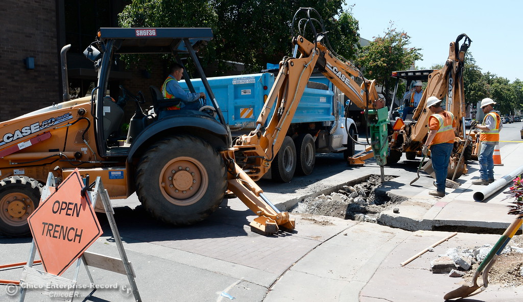 . PG&E works near the corner of Main St. and W. Third Street as PG&E is upgrading the underground electric system in downtown Chico after there was an underground cable failure and fire in June. Construction on this is expected through July 21. Tuesday July 18, 2017. (Bill Husa -- Enterprise-Record)