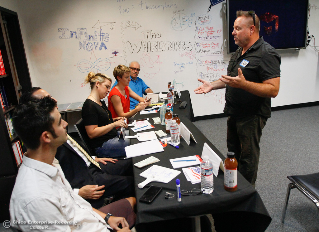 . Brian Ausland, of the Office of Education, right talks with the judges in the shark tank-like competition during the Girls Who Code Camp, (left to right) Robert Strazzarino of College Scheduler, Chico Assistant Manager Chris Constantin, Rachel Gumpy of Build.com,  Noelle Sadler of Lulus.com and Gary Loustale of Chico Unified School District board Friday July 21, 2017 in Chico, California.   (Emily Bertolino -- Enterprise-Record)