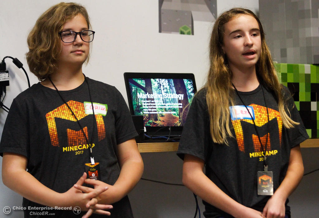 . Video game producer Corinn Richmand and game designer and storyline developer Lexi Turner talk about the video game their team created after a week of computer coding camp Friday July 21, 2017 at the Build.com office in Chico, California.   (Emily Bertolino -- Enterprise-Record)