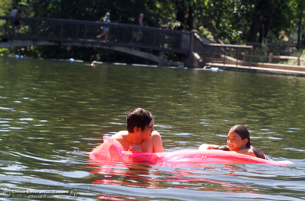 . Forest and Summer Hensiek float around Sycamore Pool, the Sacramento residents took a day trip with their family to visit Chico Wednesday July 19, 2017 in Chico, California.  (Emily Bertolino -- Enterprise-Record)
