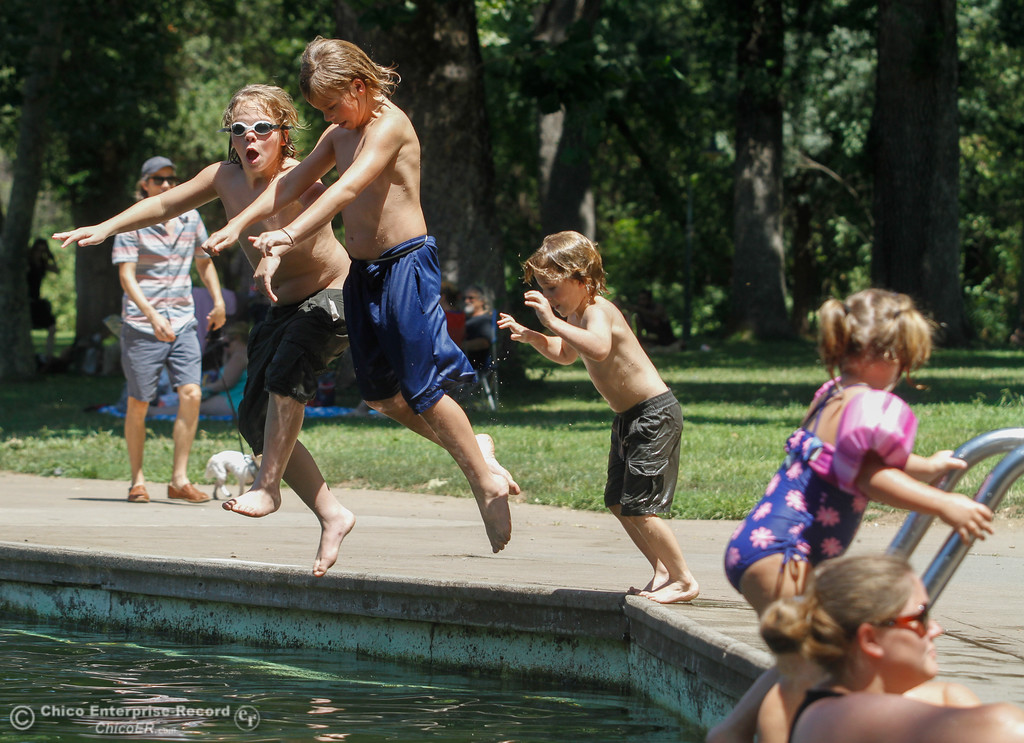 . Brothers Tyler, 11, Devin, 11, and Isack Eatmon, 6, take a leap into Sycamore Pool Wednesday July 19, 2017 at One Mile in Chico, California.  (Emily Bertolino -- Enterprise-Record)