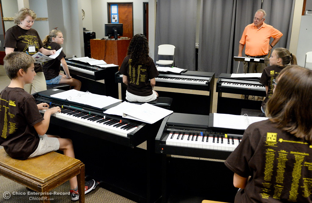 . Seven of the 34 pianists who will perform at the upcoming Monster Piano Concert practice under the direction of Dr. Allan Miller and Marci Pittman, at left at the Bidwell Presbyterian Church in Chico, Calif. Thurs. July 20, 2017. The pianists include Autumn Riley, Sarah Grace-Arington, Natalie Potkin, Daisy Ferris, Sarah Katris-Tyler, Hunter Smith and Evan Herrera. The concert is Saturday, July 22, 3:00 p.m. at Bidwell Presbyterian Church in Chico, Calif. (Bill Husa -- Enterprise-Record)