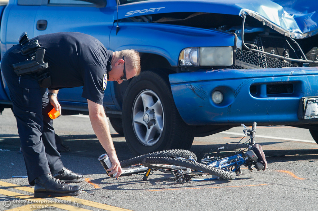 . Lt. Billy Aldridge outlines a bike was involved in an accident along Cohasset Road near Thorntree Drive in North Chico  Friday July 21, 2017 in Chico, California.   (Emily Bertolino -- Enterprise-Record)