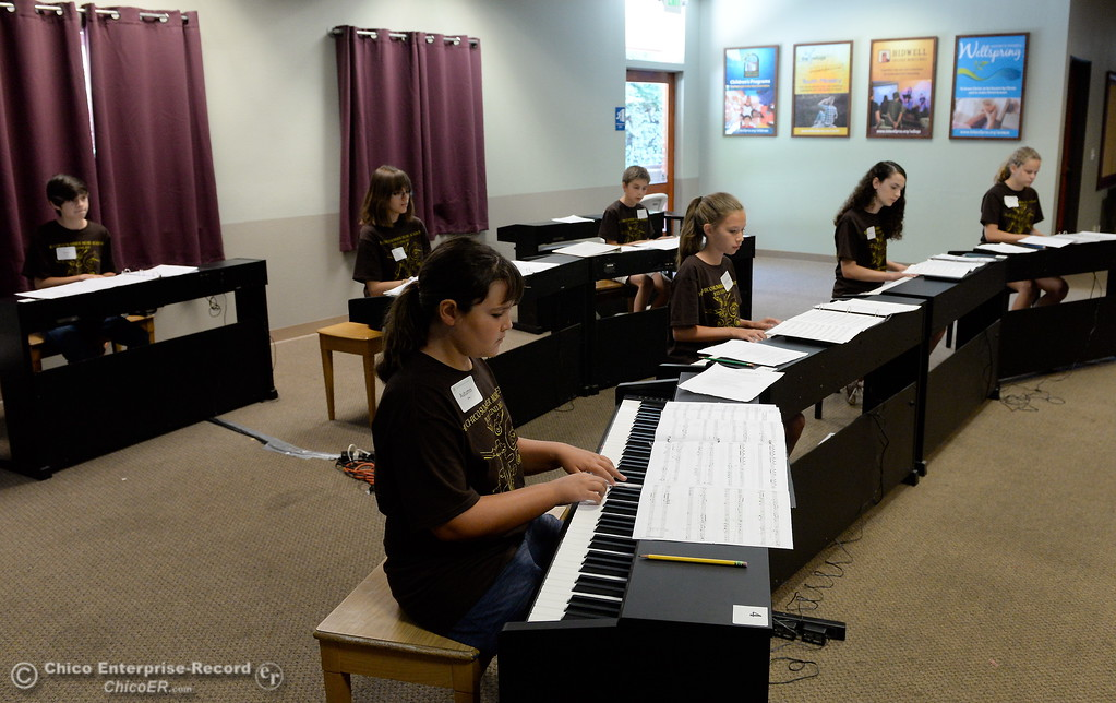 . Seven of the 34 pianists who will perform at the upcoming Monster Piano Concert practice under the direction of Dr. Allan Miller and Marci Pittman at the Bidwell Presbyterian Church in Chico, Calif. Thurs. July 20, 2017. The pianists include Autumn Riley, Sarah Grace-Arington, Natalie Potkin, Daisy Ferris, Sarah Katris-Tyler, Hunter Smith and Evan Herrera. The concert is Saturday, July 22, 3:00 p.m. at Bidwell Presbyterian Church in Chico, Calif. (Bill Husa -- Enterprise-Record)