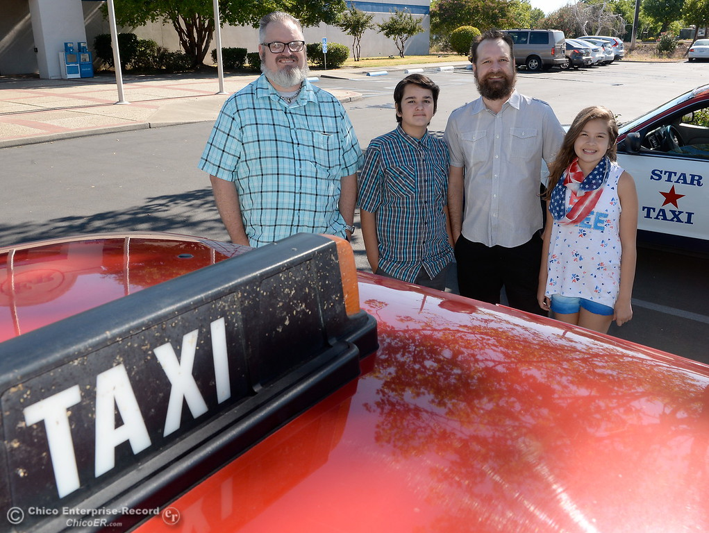 . Taxi drivers Shawn Heater, left and Erik Schmidt smile beside a cab company car with Erik\'s children Judith, 13, and Luna, 11  in Chico, Calif. Monday 7-17-2017. (Bill Husa -- Enterprise-Record)
