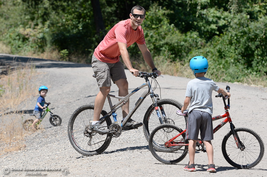 . Dad Jeff Blake enjoys a ride with 2-year-old Jason left and 6-year-old C.J. near the Five Mile Recreation area in Upper Bidwell Park in Chico, Calif. Wed. July 19, 2017. (Bill Husa -- Enterprise-Record)