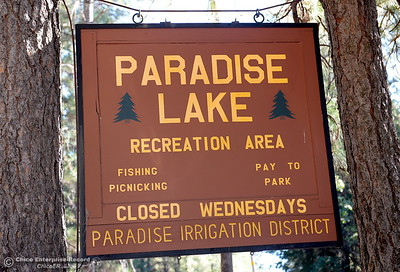 A sign is seen at an entrance to Paradise Lake that reminds visitors the lake and its facilities are closed on Wednesdays at Paradise Lake Tuesday July 18, 2017. (Bill Husa -- Enterprise-Record)