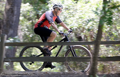 Steve Hammang of Butte Creek Canyon zips along the bike path near the Five Mile Recreation area in Upper Bidwell Park in Chico, Calif. Wed. July 19, 2017. (Bill Husa -- Enterprise-Record)