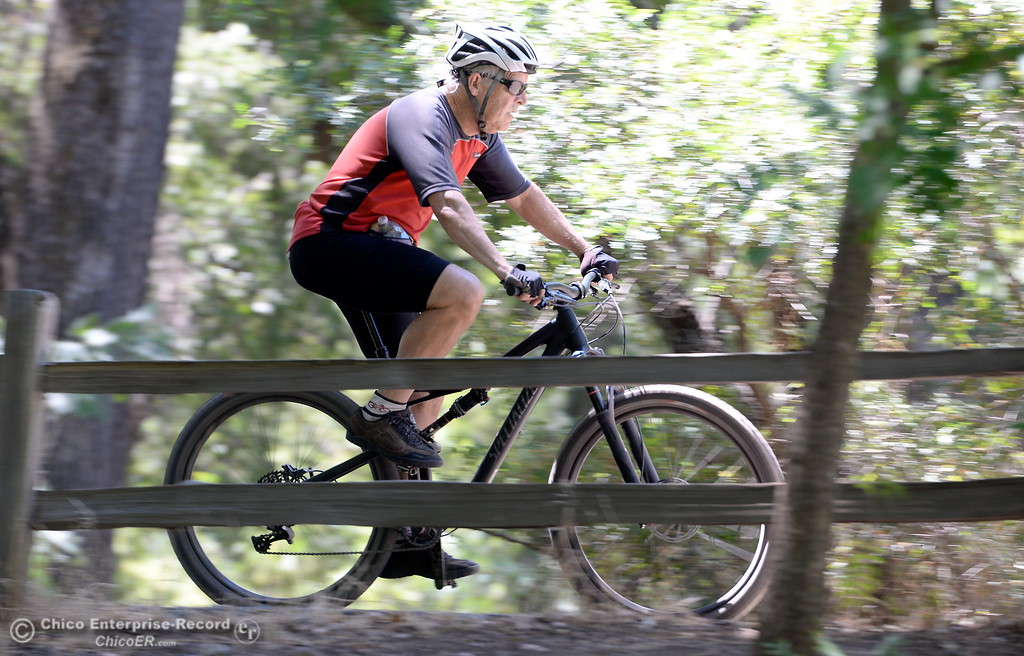 . Steve Hammang of Butte Creek Canyon zips along the bike path near the Five Mile Recreation area in Upper Bidwell Park in Chico, Calif. Wed. July 19, 2017. (Bill Husa -- Enterprise-Record)