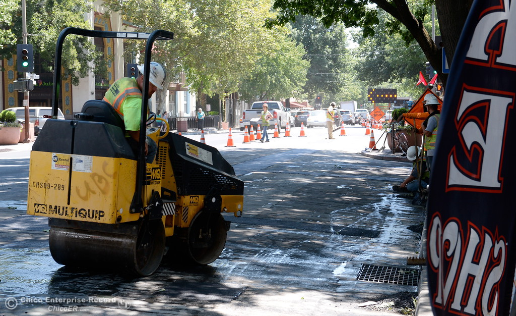. A road crew patches things up along Broadway Street while PG&E is upgrading the underground electric system in downtown Chico after there was an underground cable failure and fire in June. Construction on this is expected through July 21. Tuesday July 18, 2017. (Bill Husa -- Enterprise-Record)