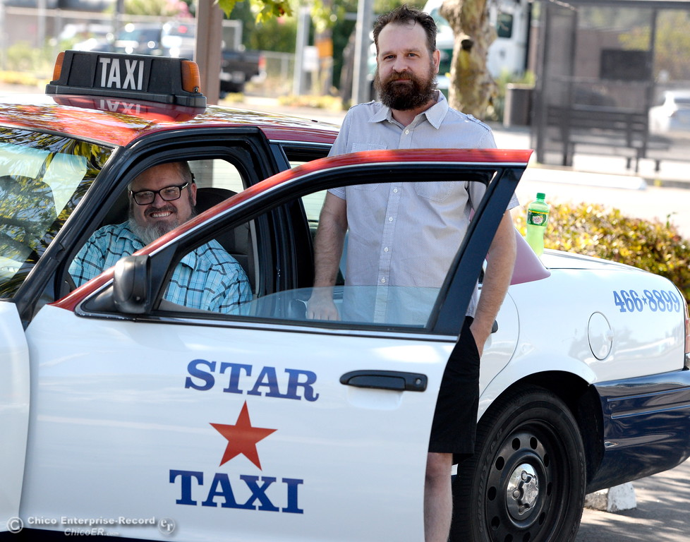 . Taxi drivers Shawn Heater, Erik Schmidt left to right smile beside a cab company car in Chico, Calif. Monday 7-17-2017. (Bill Husa -- Enterprise-Record)