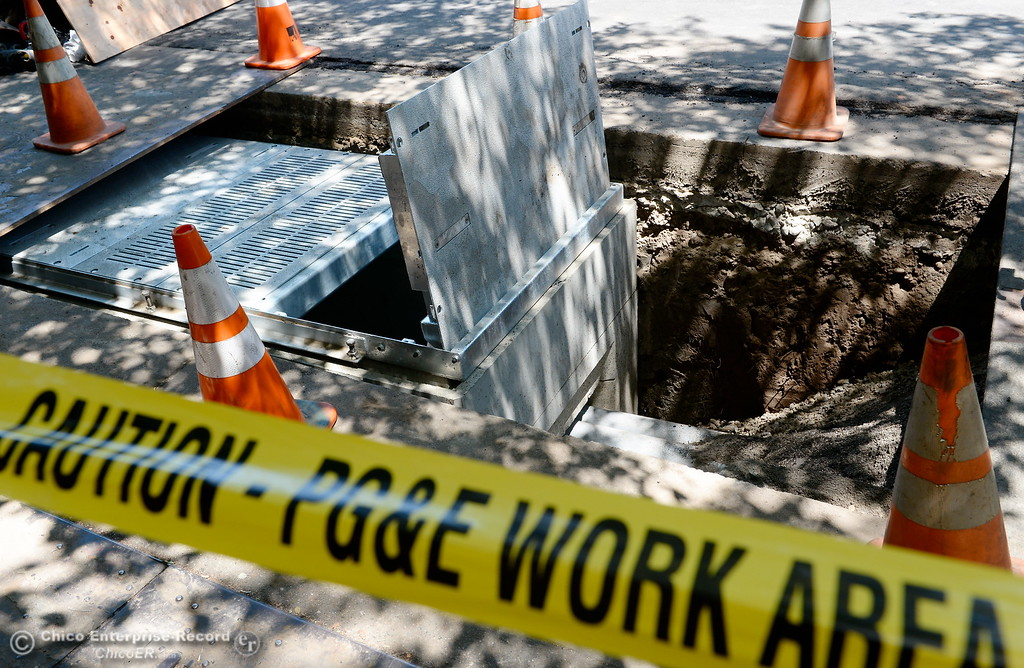 . PG&E works near the corner of Broadway and W. Third Street as PG&E is upgrading the underground electric system in downtown Chico after there was an underground cable failure and fire in June. Construction on this is expected through July 21. Tuesday July 18, 2017. (Bill Husa -- Enterprise-Record)