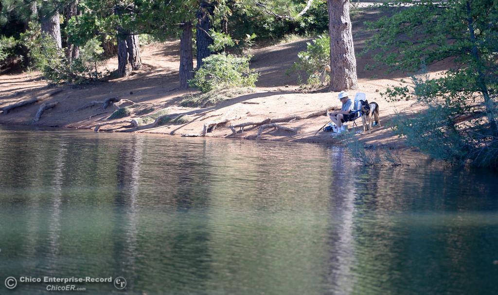 . A man and his dog enjoy a quiet morning fishing at De Sabla Reservoir in Magalia, Calif. Tuesday July 18, 2017. (Bill Husa -- Enterprise-Record)
