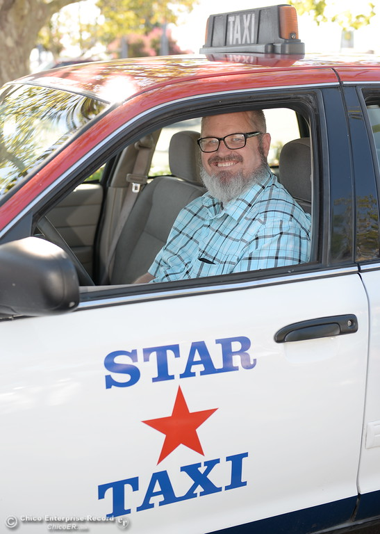 . Taxi driver Shawn Heater smiles behind the wheel of his cab company car in Chico, Calif. Monday 7-17-2017. (Bill Husa -- Enterprise-Record)
